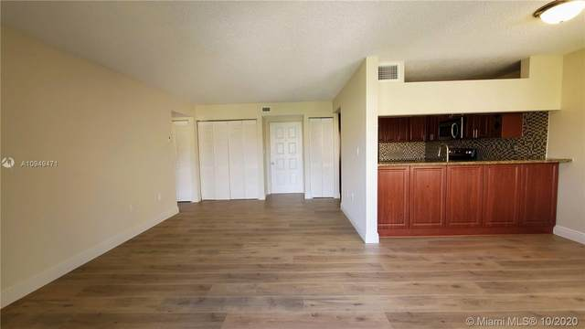 6305 Gage Pl A-307, Miami Lakes, FL 33014 (MLS #A10949471) :: Berkshire Hathaway HomeServices EWM Realty