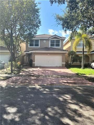 9332 NW 55th St, Sunrise, FL 33351 (MLS #A10950014) :: Miami Villa Group