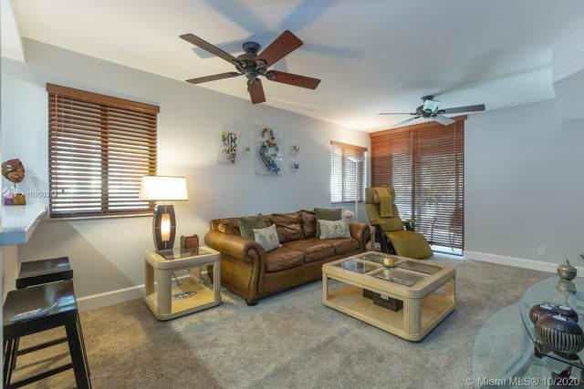 15575 Miami Lakeway N #110, Miami Lakes, FL 33014 (MLS #A10950274) :: Berkshire Hathaway HomeServices EWM Realty