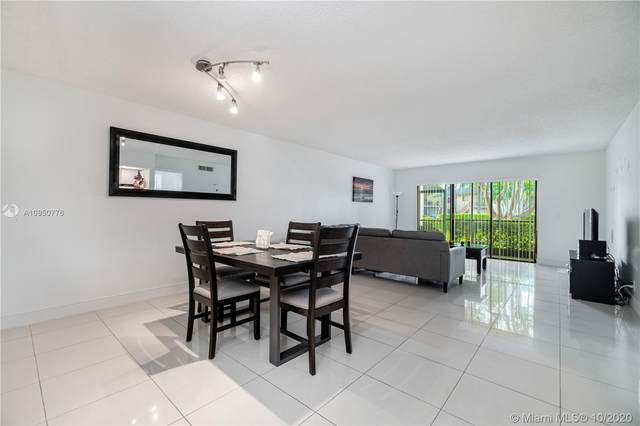 330 Racquet Club Rd #103, Weston, FL 33326 (MLS #A10950776) :: Search Broward Real Estate Team at RE/MAX Unique Realty