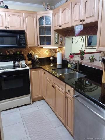 10985 SW 107th St #102, Miami, FL 33176 (MLS #A10957111) :: Berkshire Hathaway HomeServices EWM Realty