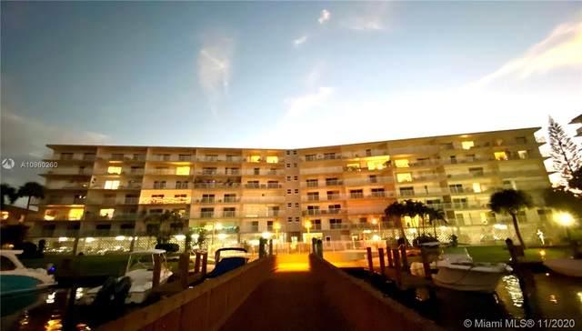 400 Golden Isles Dr #5, Hallandale Beach, FL 33009 (MLS #A10960260) :: Berkshire Hathaway HomeServices EWM Realty