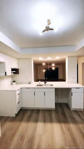 16141 Blatt Blvd #404, Weston, FL 33326 (MLS #A10961796) :: Berkshire Hathaway HomeServices EWM Realty