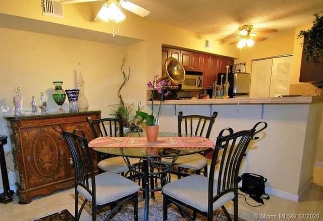 1715 Village Blvd #108, West Palm Beach, FL 33409 (MLS #A10966809) :: Patty Accorto Team
