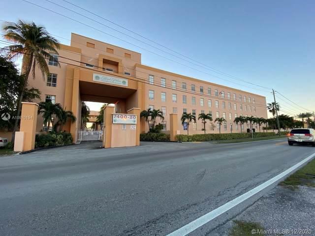 7400 W 20th Ave #407, Hialeah, FL 33016 (MLS #A10970194) :: The Teri Arbogast Team at Keller Williams Partners SW
