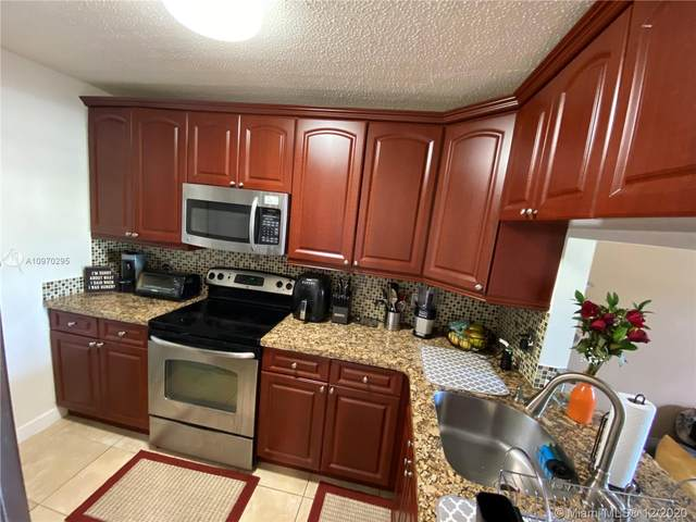 10040 Winding Lake Rd #101, Sunrise, FL 33351 (MLS #A10970295) :: Berkshire Hathaway HomeServices EWM Realty