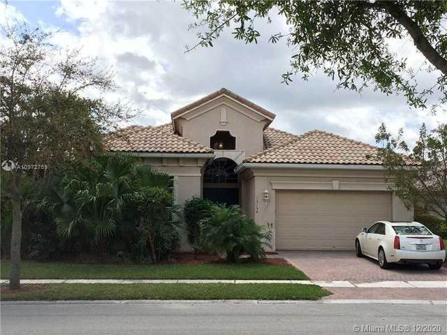 12154 NW 76th Pl, Parkland, FL 33076 (MLS #A10972759) :: THE BANNON GROUP at RE/MAX CONSULTANTS REALTY I