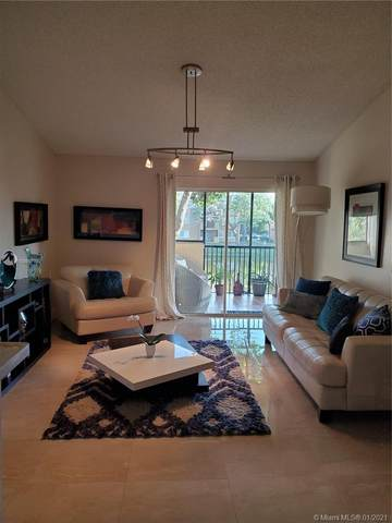 8471 SW 5th St #205, Pembroke Pines, FL 33025 (MLS #A10980771) :: The Teri Arbogast Team at Keller Williams Partners SW