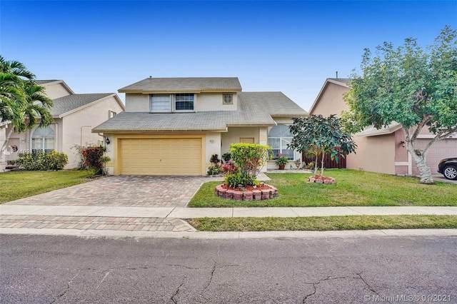 12256 NW 31st St, Sunrise, FL 33323 (MLS #A10981733) :: Berkshire Hathaway HomeServices EWM Realty