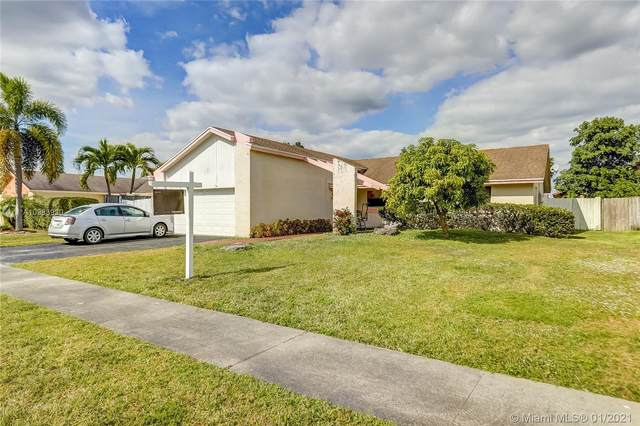8541 NW 48th St, Lauderhill, FL 33351 (MLS #A10983930) :: THE BANNON GROUP at RE/MAX CONSULTANTS REALTY I