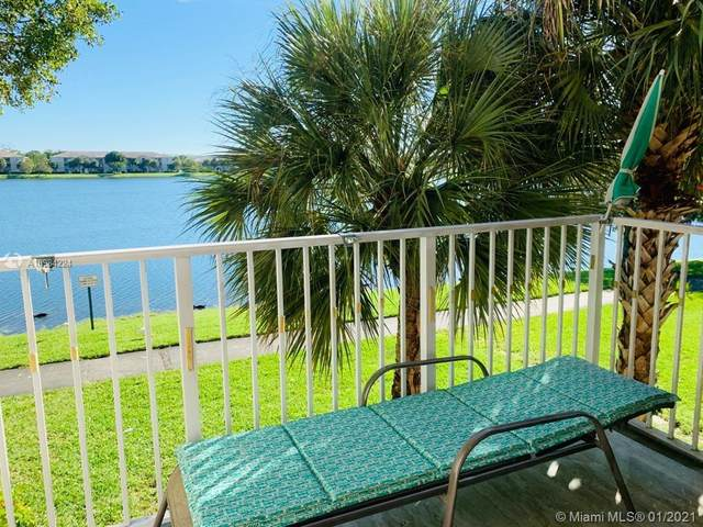 5015 Wiles Rd #206, Coconut Creek, FL 33073 (MLS #A10984224) :: Berkshire Hathaway HomeServices EWM Realty