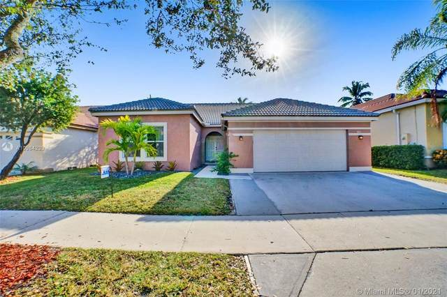 390 Carrington Dr, Weston, FL 33326 (MLS #A10984239) :: Berkshire Hathaway HomeServices EWM Realty