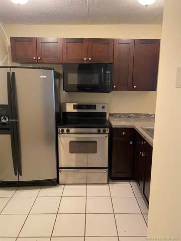 488 NW 165th St Rd B311, Miami, FL 33169 (MLS #A10984619) :: Berkshire Hathaway HomeServices EWM Realty