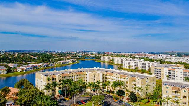 10700 NW 66th St #206, Doral, FL 33178 (MLS #A10985121) :: Berkshire Hathaway HomeServices EWM Realty