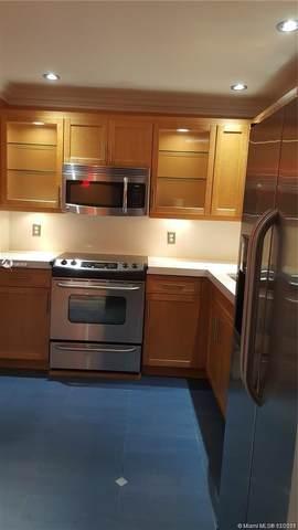401 Golden Isles Dr #101, Hallandale Beach, FL 33009 (MLS #A10987505) :: Castelli Real Estate Services