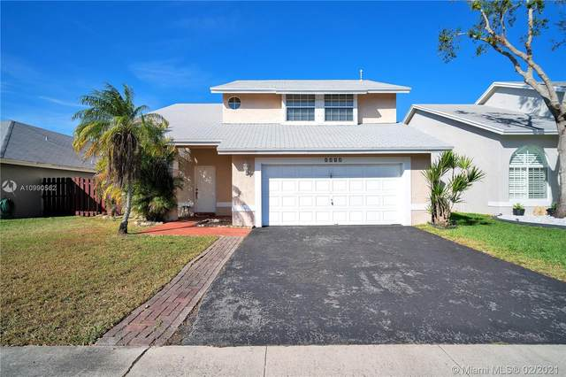 3161 NW 122nd Ter, Sunrise, FL 33323 (MLS #A10990562) :: Berkshire Hathaway HomeServices EWM Realty