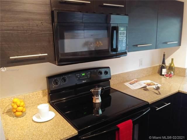 9410 Live Oak Pl #409, Davie, FL 33324 (MLS #A10993707) :: Berkshire Hathaway HomeServices EWM Realty