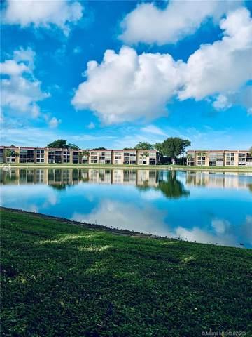 6240 Coral Lake Dr #404, Margate, FL 33063 (MLS #A10998397) :: Berkshire Hathaway HomeServices EWM Realty