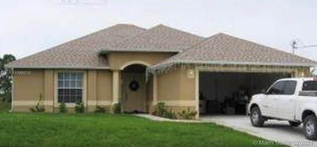 616 S Montclair Ave, Lehigh Acres, FL 33974 (MLS #A10999218) :: The Teri Arbogast Team at Keller Williams Partners SW