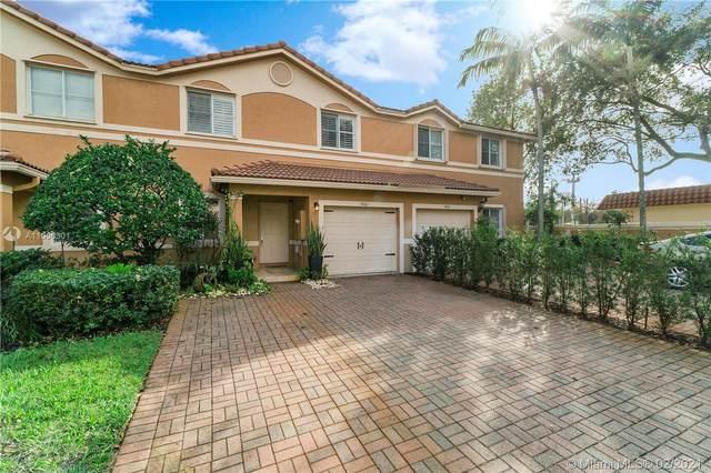 9880 NW 24th St, Sunrise, FL 33322 (MLS #A11000301) :: Berkshire Hathaway HomeServices EWM Realty