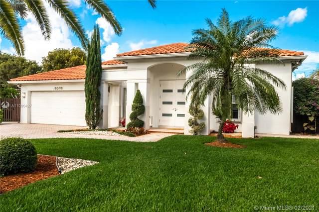 6598 NW 113th Pl, Doral, FL 33178 (MLS #A11000427) :: All Florida Home Team
