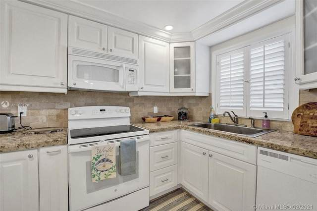 9450 Live Oak Pl #106, Davie, FL 33324 (MLS #A11001285) :: Berkshire Hathaway HomeServices EWM Realty