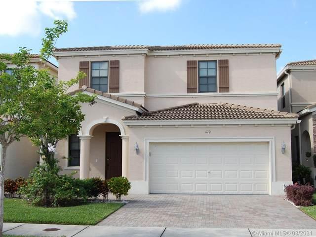 672 NE 191st St, Miami, FL 33179 (MLS #A11006354) :: Berkshire Hathaway HomeServices EWM Realty