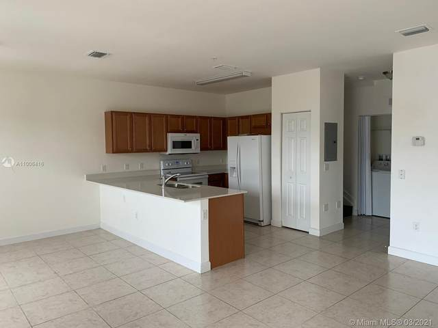 230 NW 109th Ave #216, Miami, FL 33172 (MLS #A11006416) :: Prestige Realty Group