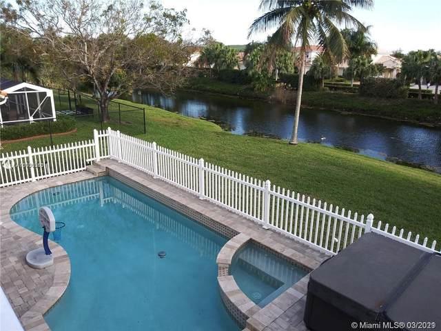 3910 NW 54th Ct, Coconut Creek, FL 33073 (MLS #A11006560) :: Berkshire Hathaway HomeServices EWM Realty