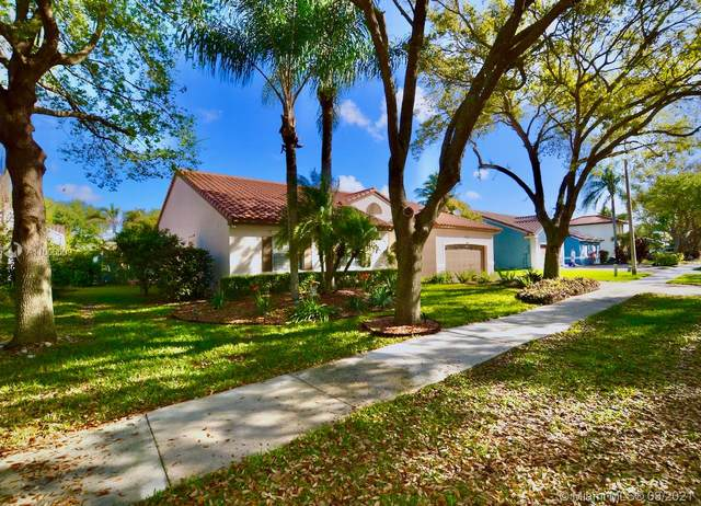 4461 NW 63rd Dr, Coconut Creek, FL 33073 (MLS #A11006609) :: Berkshire Hathaway HomeServices EWM Realty