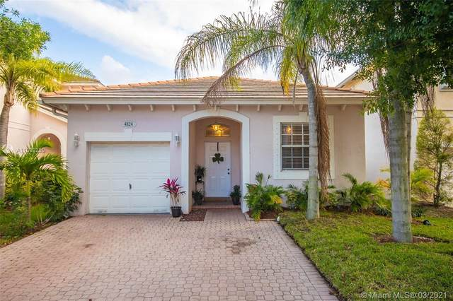 4824 NW 20th Pl, Coconut Creek, FL 33063 (MLS #A11009289) :: Berkshire Hathaway HomeServices EWM Realty