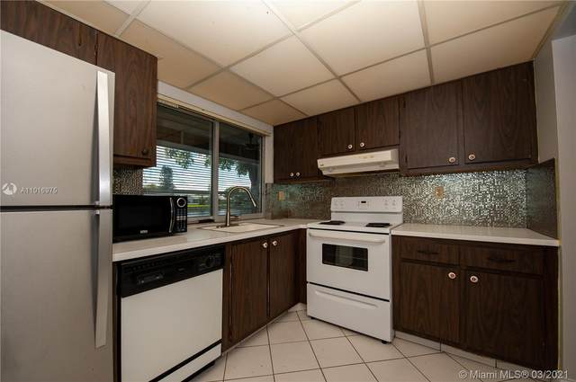 9330 Lime Bay Blvd #108, Tamarac, FL 33321 (MLS #A11016975) :: Search Broward Real Estate Team
