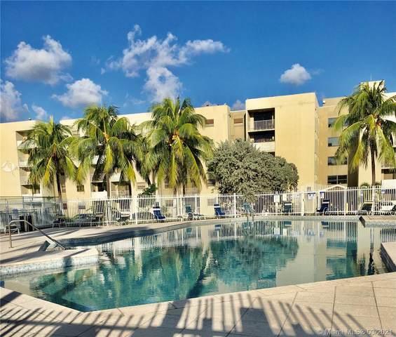 8145 NW 7th St #311, Miami, FL 33126 (MLS #A11018575) :: Compass FL LLC