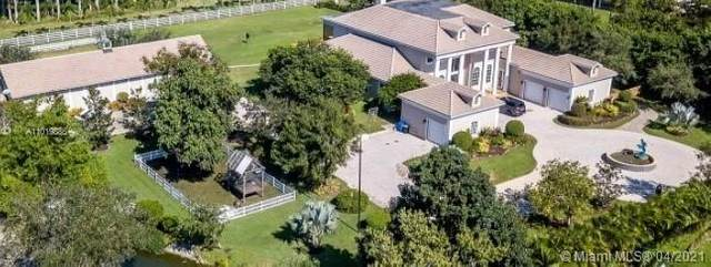 12800 Hunters Pt, Southwest Ranches, FL 33330 (MLS #A11019886) :: The Teri Arbogast Team at Keller Williams Partners SW