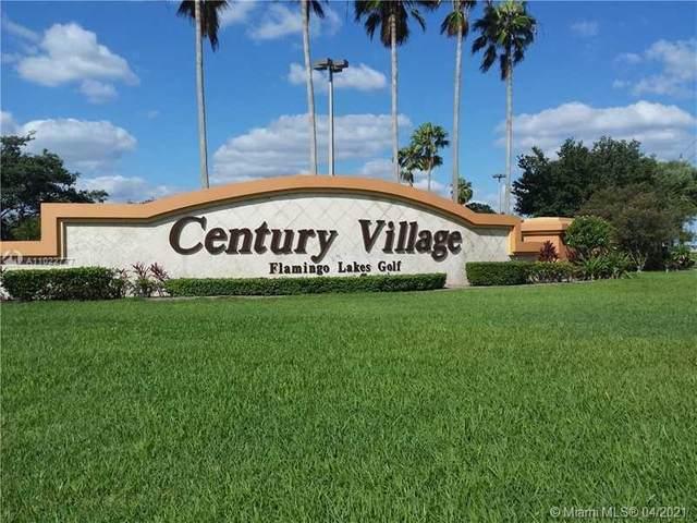 301 SW 135th Ave 406C, Pembroke Pines, FL 33027 (MLS #A11022777) :: The Teri Arbogast Team at Keller Williams Partners SW