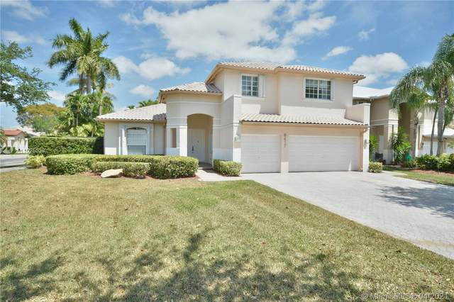 6417 NW 113th Pl, Doral, FL 33178 (MLS #A11025039) :: The Riley Smith Group