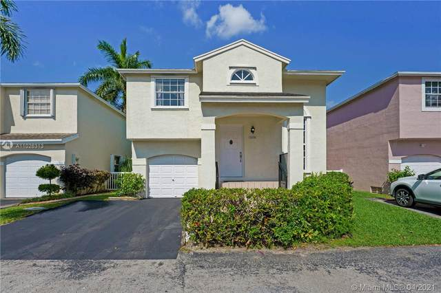 12024 NW 13th St, Pembroke Pines, FL 33026 (MLS #A11026313) :: The Teri Arbogast Team at Keller Williams Partners SW
