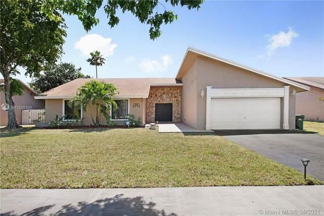 8310 NW 54th Ct, Lauderhill, FL 33351 (MLS #A11026355) :: Berkshire Hathaway HomeServices EWM Realty