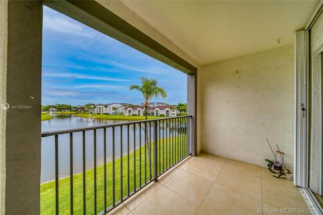 4420 NW 107th Ave #302, Doral, FL 33178 (MLS #A11027641) :: Equity Advisor Team