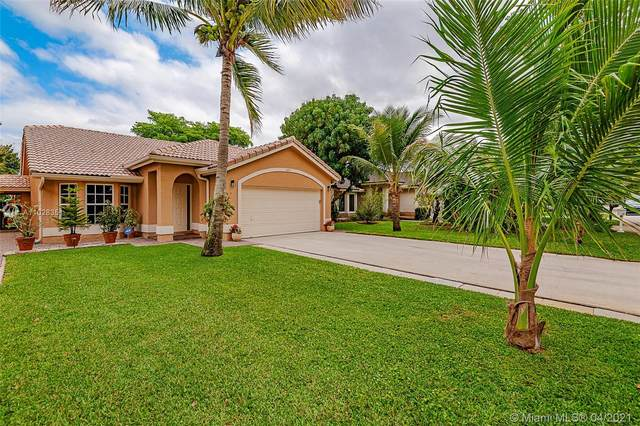 2419 NW 95th Ave, Coral Springs, FL 33065 (MLS #A11028351) :: The Teri Arbogast Team at Keller Williams Partners SW