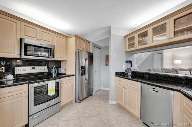 9121 W Sunrise Blvd #9121, Plantation, FL 33322 (MLS #A11028976) :: Castelli Real Estate Services