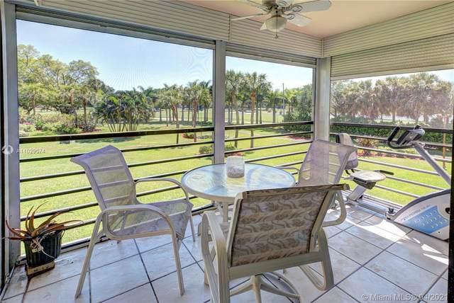 900 Saint Charles Pl #203, Pembroke Pines, FL 33026 (MLS #A11029074) :: Castelli Real Estate Services