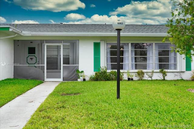 1063 NW 85th Ter B111, Plantation, FL 33322 (MLS #A11034618) :: The Teri Arbogast Team at Keller Williams Partners SW