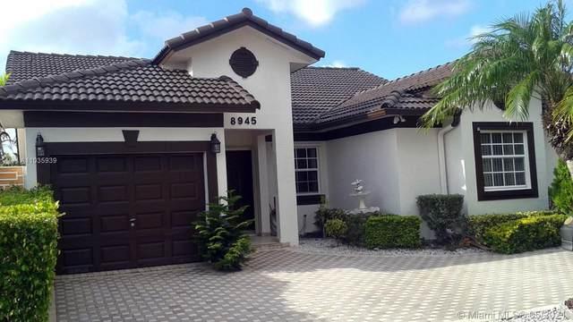 8945 NW 148th St, Miami Lakes, FL 33018 (MLS #A11035939) :: Berkshire Hathaway HomeServices EWM Realty