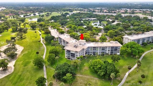 3800 Oaks Clubhouse Dr #202, Pompano Beach, FL 33069 (MLS #A11037837) :: Vigny Arduz   RE/MAX Advance Realty