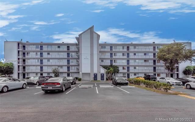 8740 N Sherman Cir #403, Miramar, FL 33025 (MLS #A11038784) :: Search Broward Real Estate Team