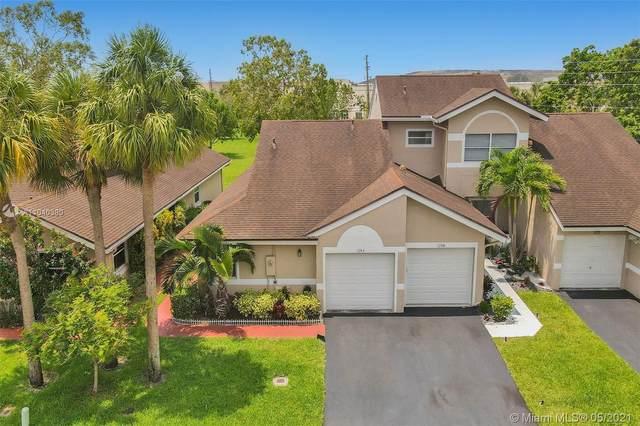 1264 NW 52nd Way #1264, Deerfield Beach, FL 33442 (MLS #A11040380) :: Berkshire Hathaway HomeServices EWM Realty