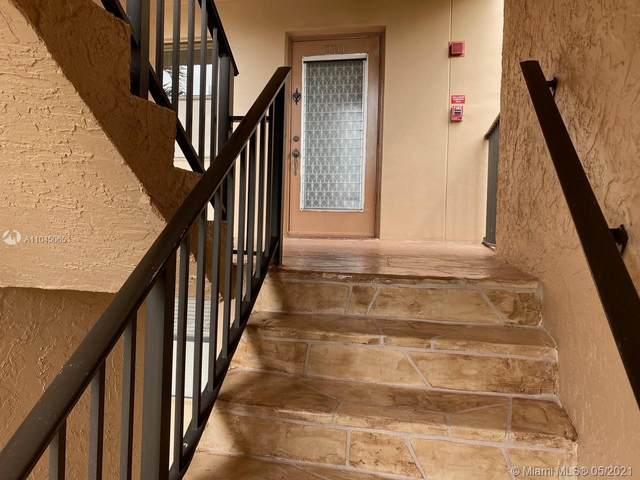 10400 NW 30th Ct #210, Sunrise, FL 33322 (MLS #A11045065) :: Berkshire Hathaway HomeServices EWM Realty