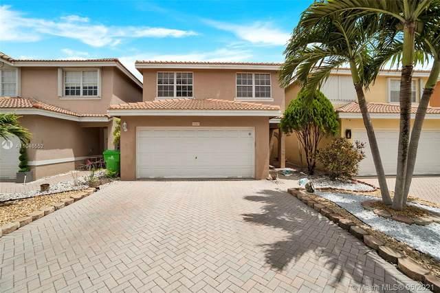 9267 NW 55th St, Sunrise, FL 33351 (MLS #A11046552) :: Douglas Elliman