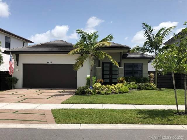 8820 NW 155th Ter, Miami Lakes, FL 33018 (MLS #A11047015) :: Berkshire Hathaway HomeServices EWM Realty
